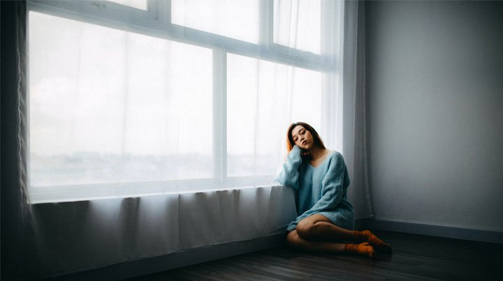 Young woman looking very sad and alone